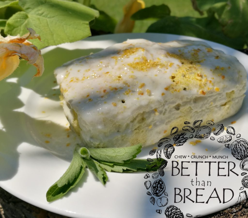 Better Than Bread Lemon Cake, garnished with stevia leaves.